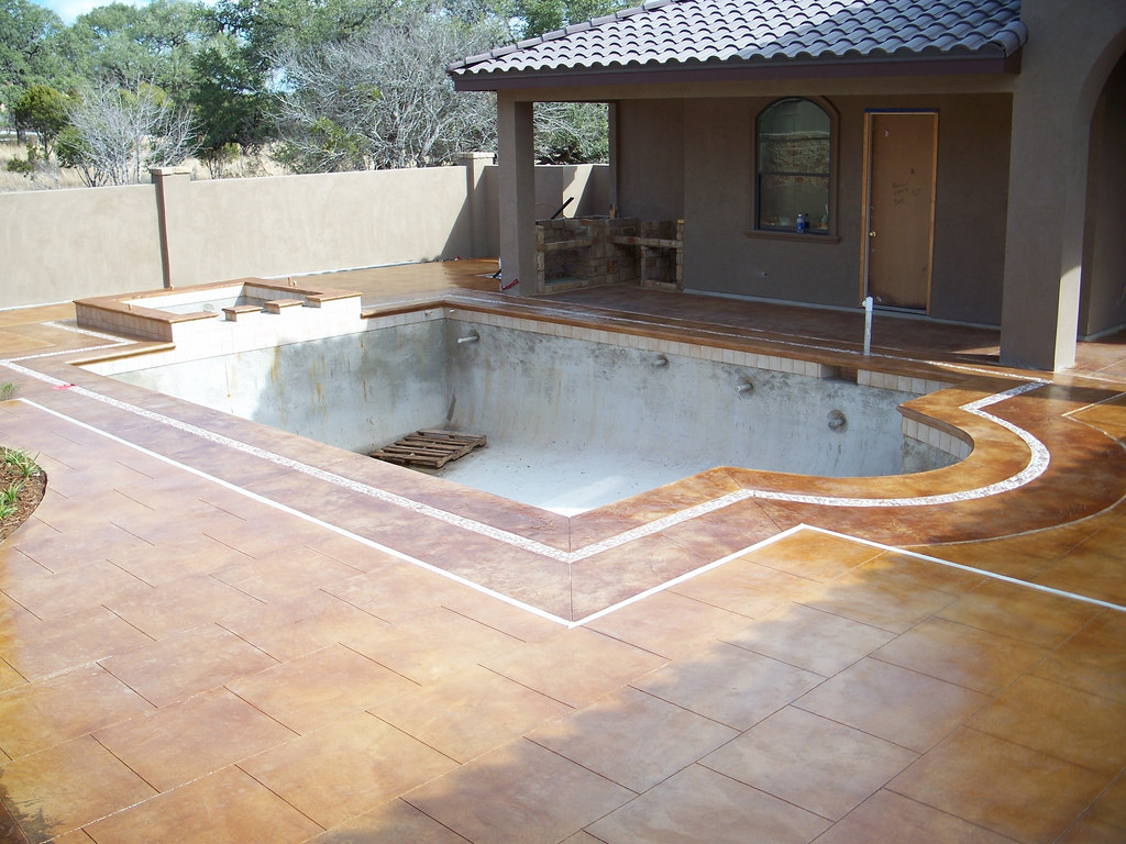 How Decorative Concrete Can Enhance Your Pool Deck and Add Value
