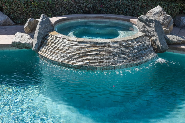 Three Reasons to Add a Water Feature to Your Custom Pool